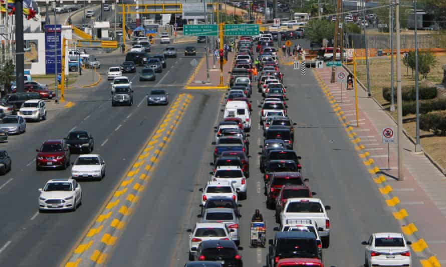 Cars wait to cross the bridge that connects the cities of El Paso and Ciudad Juarez, on Friday.