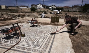 An archaeologist works on a mosaic on the archaeological antiquity site of Sainte-Colombe, near Vienne.