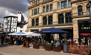 Busy outdoor beer gardens in Manchester, England.
