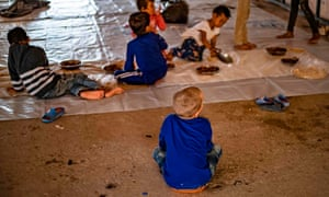 Orphans reportedly linked with foreign fighters of Islamic State gather to eat at a camp in the northern Syrian village of Ain Issa, on 26 September, 2019.