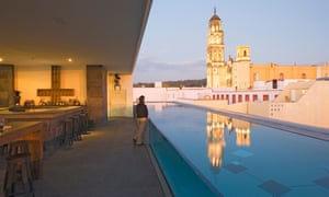 The roof terrace of the La Purificadora hotel has a view of Convento de San Francisco, in Puebla, Mexico