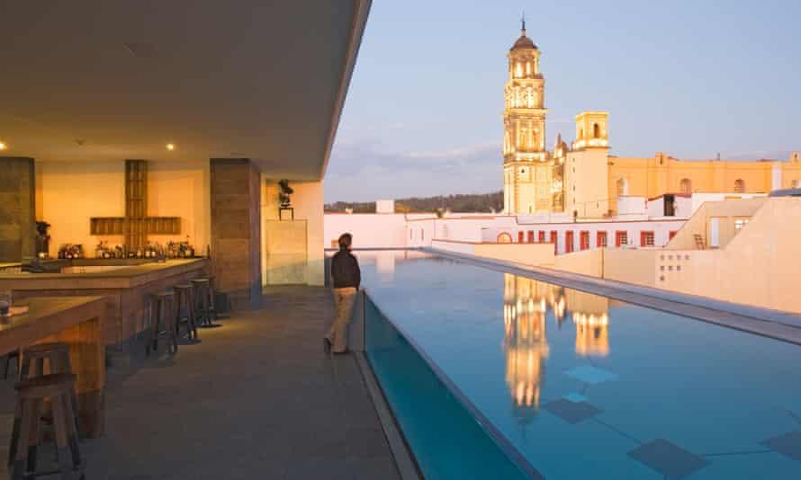 The roof terrace of the La Purificadora hotel has a view of Convento de San Francisco, in Puebla, Mexico