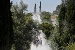 The pack rides through the countryside during the one-day classic cycling race Strade Bianche around Siena in Tuscany.