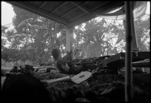A Cambodian government soldier firing his outdated M1 carbine at the Khmer Rouge from a fox hole. Kien Svay, Route 1, Cambodia 1973.