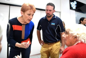 Pauline Hanson chats to an elderly local resident as she campaigns with the One Nation candidate for Longman, Matthew Stephen (centre) in Caboolture, on 4 July.