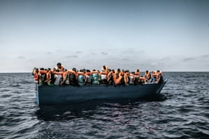 Refugees and migrants on a boat