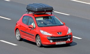 Vauxhall car fitted with a large roof box