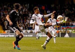 Tottenham's Dele Alli attempts to control the ball.