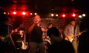 Big Bear does the 'Bear Claw' as the band Toxic Bears play at Niman Denatsu in Tokyo in October.