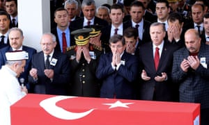 Turkey's president Recep Tayyip Erdoğan (second from right) is among the mourners at the funeral of an army officer killed this week in Diyarbakir