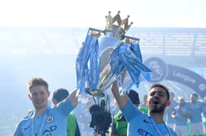 Kevin De Bruyne and Bernardo Silva celebrate with the trophy.