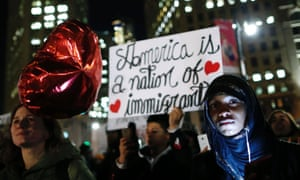 Demonstrators hold signs at the New York Immigration Coalition's rally on Valentine's Day.