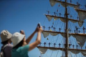 Sailors standing on mast