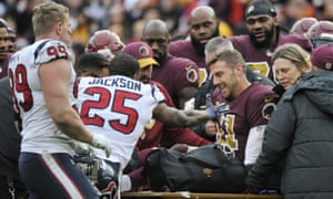 Alex Smith is comforted by teammates and opponents after his injury against the Houston Texans