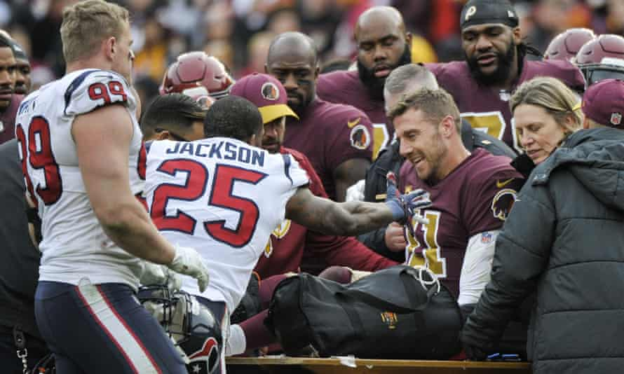 Houston Texans strong safety Kareem Jackson (25) reaches for Alex Smith as he leaves the field after his injury in 2018