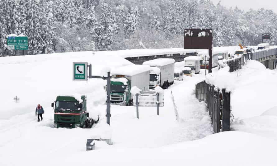 Vehicles stranded on the snow-covered Kanetsu expressway in Minamiuonuma in Niigata prefecture, Japan