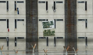 """A poster hanging from La Picota prison in Bogota reads """"Millions of Colombians ignore what it means to live in prison""""."""
