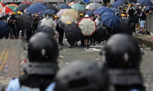 Protesters face police during a mass protest in Hong Kong on Wednesday.