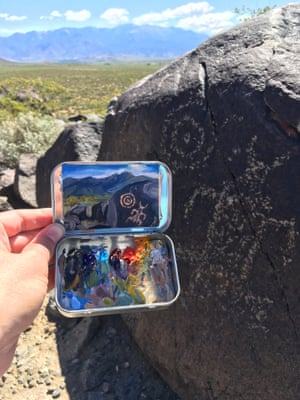 Heidi Annalise paints panoramic landscapes into small mint tins.