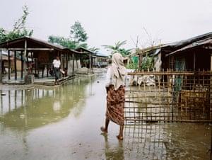 Monsoon rain settles at a Rohingya IDP camp