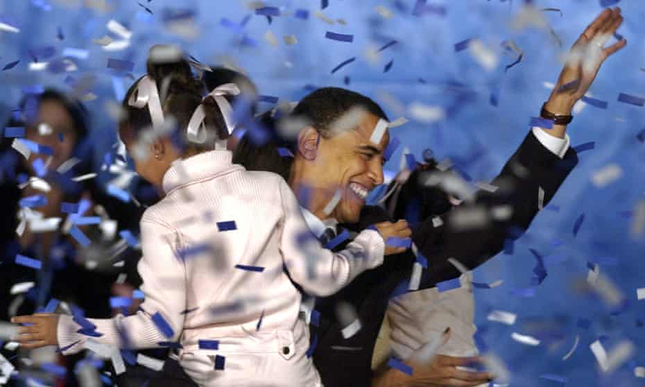 Barack Obama, with his daughter Malia, celebrates becoming the fifth black US senator to be elected, November 2004.