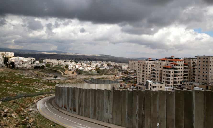 The Israeli barrier running between the East Jerusalem refugee camp of Shuafat and Pisgat Zeev