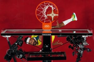 Patty Mills of Australia scores a basket against Germany.