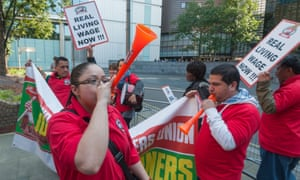Cleaners protest for living wages at Southwark crown court in London.
