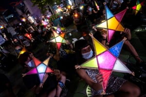 Protesters hold lanterns at an anti-government demonstration in Bangkok.