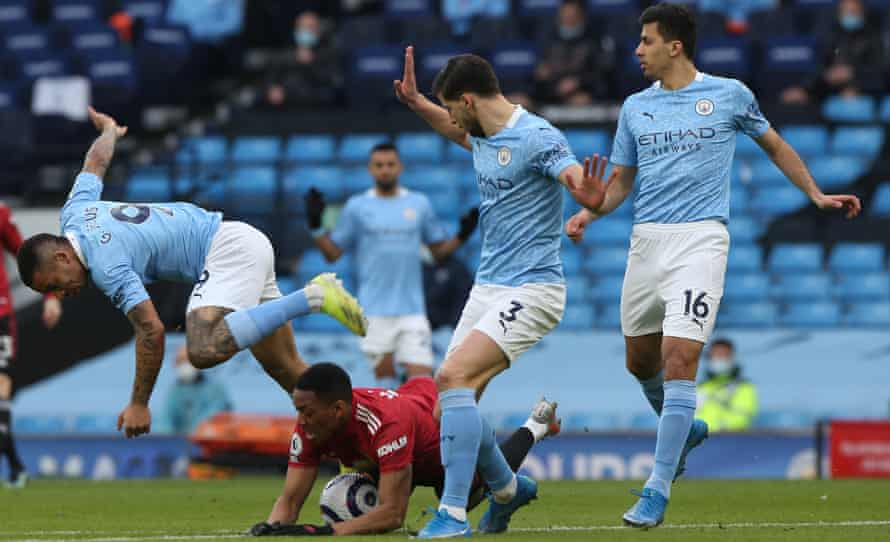 Anthony Martial is fouled by Gabriel Jesus, leading to Manchester United's early penalty