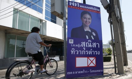 An election poster in Bangkok for Sunisa Tiwakorndamrong, a candidate for Pheu Thai, one of the parties that could be affected by new social media restrictions.