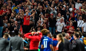 Manchester United's fans celebrate with the players after the Europa League final victory.