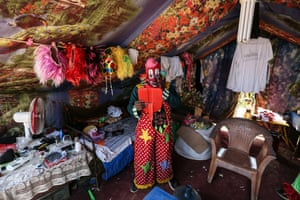 Biju Nair, a clown, gets ready for his performance at the Rambo Circus in Mumbai