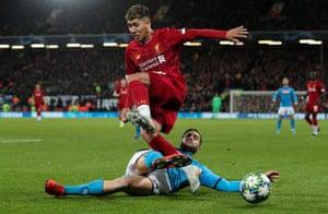 Liverpool's Roberto Firmino is tackled by Napoli's Konstantinos Manolas.