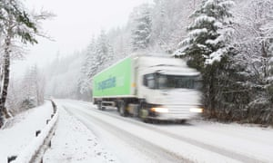 A lorry driver delivers food during the festive season in the Scottish Highlands. Hauliers say too few young people can afford to get a licence to drive lorries.