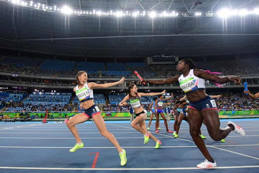 Anyika Onuora hands the baton to Kelly Massey in round one of the 4x400m relay in Rio