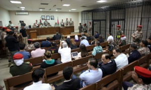Jordanian judges reside over the trial of Maarik Al-Tawaiha, charged with the killing of three American military trainers outside an army base last year.