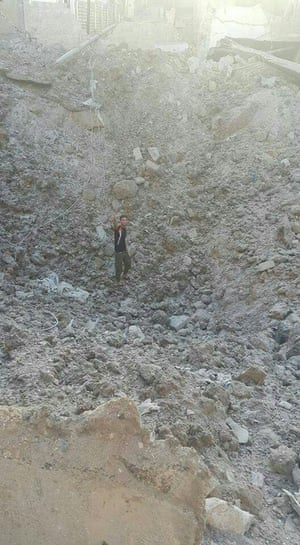The crater left by the explosion of an alleged bunker-buster bomb in Tariq al Bab neighbourhood.