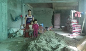 A family living on a building site in Sanchaung township, Yangon.