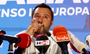 The far-right League party leader and Italy's deputy prime minister, Matteo Salvini, kisses a crucifix