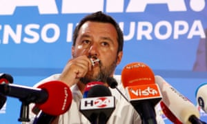The League's Matteo Salvini kisses a crucifix during the European election results announcement in Milan