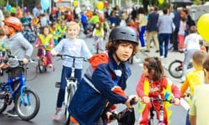 Children ride bikes on closed streets in Tirana.