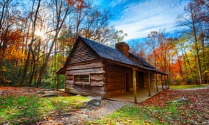 A typical image of a log cabin with natural space all around