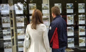 People look in an estate agent's window