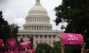 Women hold up signs during a women's pro-choice rally on on 11 July 2013 in Washington, DC.