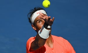 Rafael Nadal serves on his way to a straight-sets win against Fabio Fognini at the Australian Open in Melbourne.