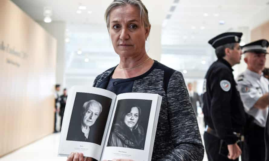 The lung specialist Irène Frachon poses with a book depicting portraits of 'Mediator victims' at the courthouse in Paris before the start of the Servier trial in September 2019.
