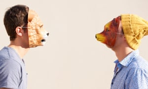 Facing off<br>Two young hipsters facing off while wearing animal masks