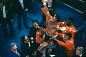 Leon Spinks, with his entourage holding him aloft, celebrates his 15-round split decision victory against the world heavyweight champion Muhammad Ali in Las Vegas.