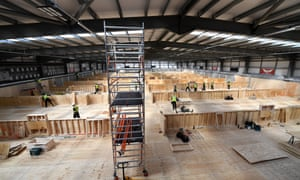 Construction work takes place in preparation for the installation of hospital beds in Llanelli, Wales, March 2020